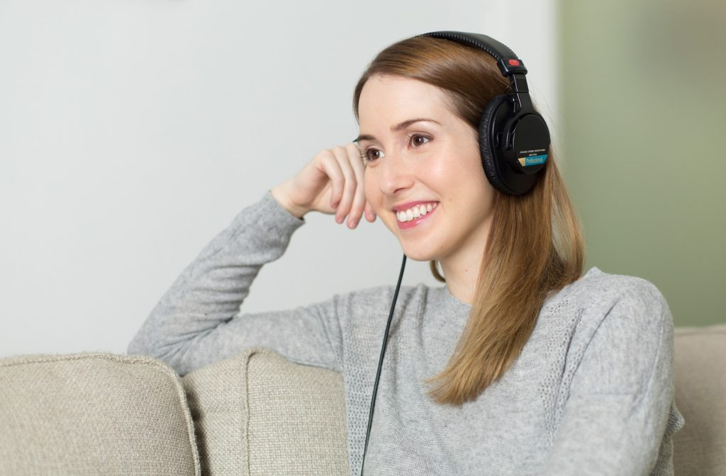 woman listening to book